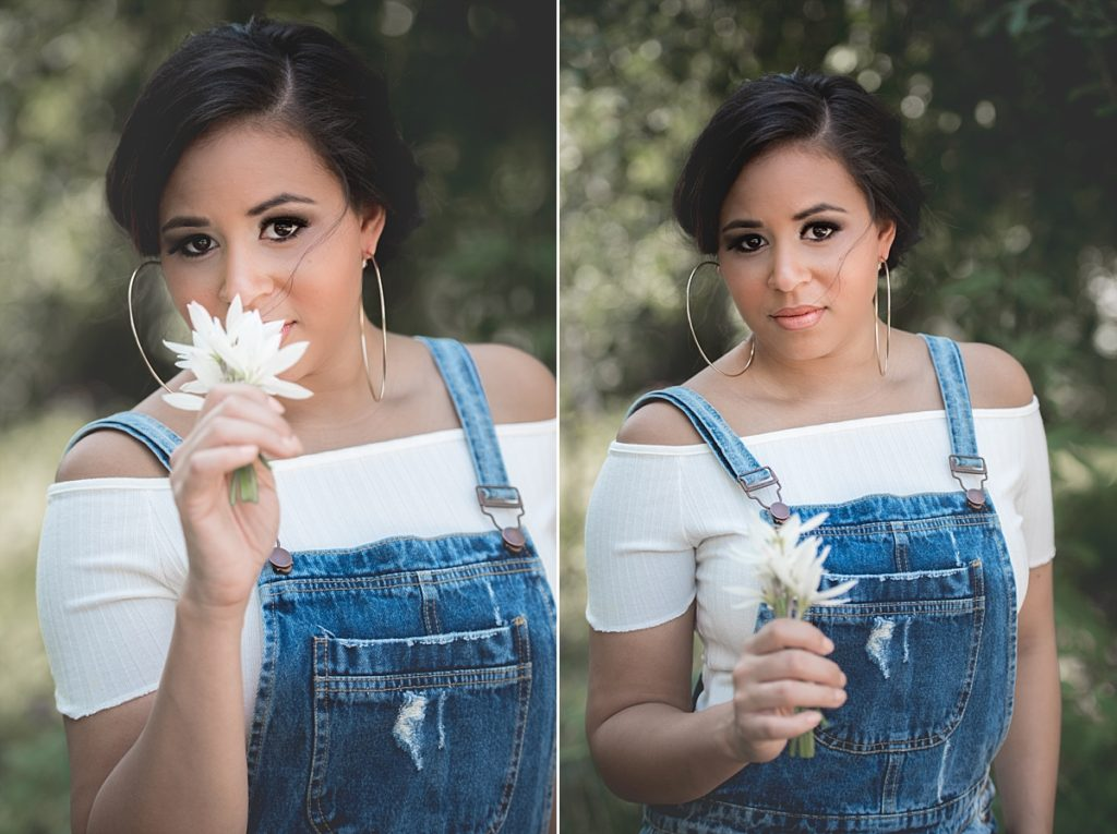 Cutests overalls and teen smelling flowers.